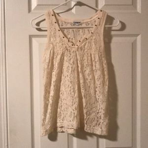 Cream colored tank with gold studs